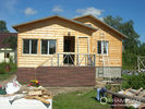 Cabanes en rondins en bois modernes de structure métallique, maisons préfabriquées de pavillon d'isolation élevée